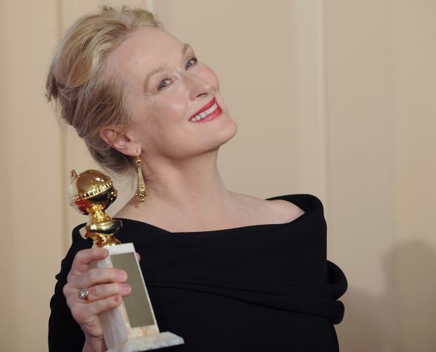 "Meryl Streep poses with the award for best actress in a motion picture, comedy or musical for ""Julie and Julia"" backstage at the 67th Annual Golden Globe Awards on Sunday, Jan. 17, 2010, in Beverly Hills, Calif. (AP Photo/Mark J. Terrill)"
