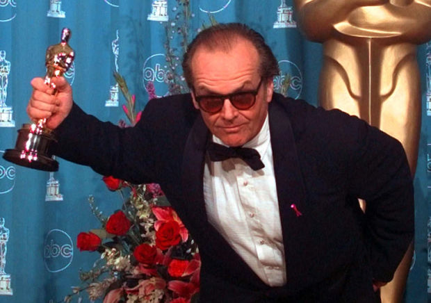 Jack Nicholson gestures with his Oscar for Best Actor at the 70th annual Academy Awards at the Shrine Auditorium in Los Angeles, Monday, March 23, 1998. Nicholson won for his role in 'As Good As It Gets.' (AP Photo/Mark J. Terrill)