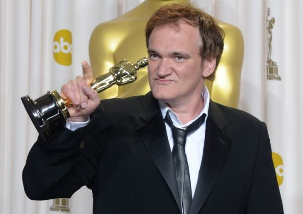Quentin Tarantino holds the trophy for Best Original Screenplay in the press room during the 85th Annual Academy Awards on February 24, 2013 in Hollywood, California. AFP PHOTO / JOE KLAMAR