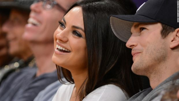 Actors Ashton Kutcher (R) and Mila Kunis (L) sit courtside at the Los Angeles Lakers NBA match up against the Phoenix Suns, at Staples Center in Los Angeles, California, February 12, 2013. The Lakers defeated the Suns, 91-85. Kobe Bryant finishes with only four points, nine assists and eight turnovers. AFP PHOTO Robyn BECK (Photo credit should read ROBYN BECK/AFP/Getty Images)