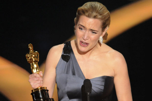 """**EMBARGOED AT THE REQUEST OF THE ACADEMY OF MOTION PICTURE ARTS & SCIENCES FOR USE UPON CONCLUSION OF THE ACADEMY AWARDS TELECAST** British actress Kate Winslet accepts the Oscar for best actress for her work in """"The Reader"""" during the 81st Academy Awards Sunday, Feb. 22, 2009, in the Hollywood section of Los Angeles. (AP Photo/Mark J. Terrill)"""