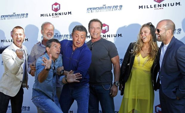 """(L-R) Cast members Glen Powell, Kelsey Grammer, Antonio Banderas, Sylvester Stallone, Arnold Schwarzenegger, Ronda Rousey and Jason Statham pose during a photocall on the Croisette to promote the film """"The Expendables 3"""" during the 67th Cannes Film Festival in Cannes May 18, 2014. REUTERS/Yves Herman (FRANCE - Tags: ENTERTAINMENT TPX IMAGES OF THE DAY)"""