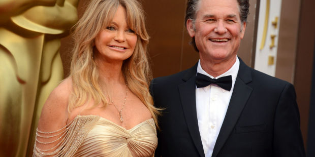 Goldie Hawn, left, and Kurt Russell arrive at the Oscars on Sunday, March 2, 2014, at the Dolby Theatre in Los Angeles. (Photo by Jordan Strauss/Invision/AP)